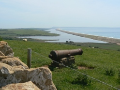 View of Chesil Beach, with a nod to a less peaceful past!