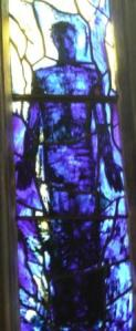Stained glass depiction of Jesus in Gloucester Cathedral