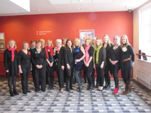 Laughter and Lyrics Choir I'm the white haired one 7th from left and caroline is the gorgeous oneon the right of the middle