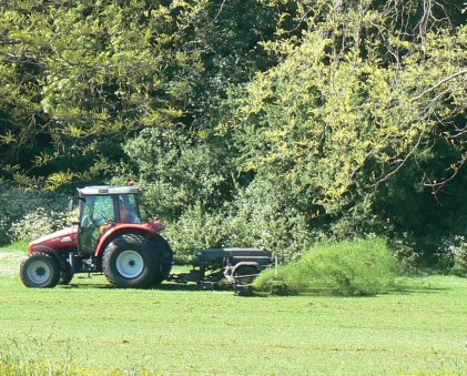 red tractor cutting the grass