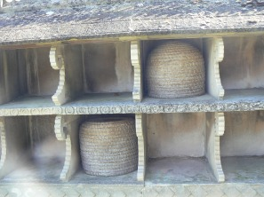 baskets in bee wall