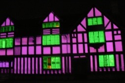 Light show projected onto the wall of William Shakespeare's Birthplace in Stratford on Avon