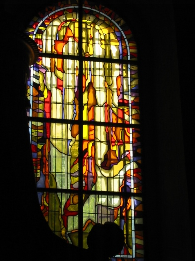 Vibrant citrus colours in a Stained Glass Window in Krakow, Poland