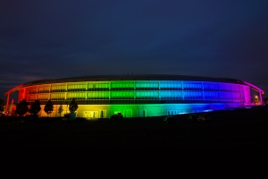 Doughnut building enveloped in rainbow lights copyright GCHQ, used with permission
