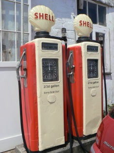 Orange petrol pumps long disused in Cornwall