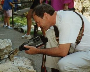 My very young looking husband with a very old looking camera getting close up!
