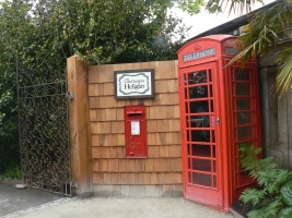 Doors on Phone box and post box at entrance to Lost garden of Heligan