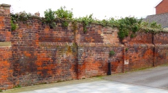 Ancient wall by the original tramroad at Gloucester Docks
