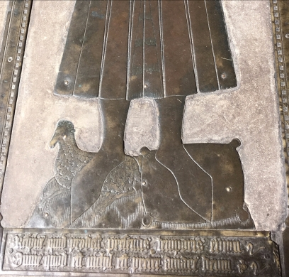 Detail of brass showing woolsack and sheep