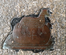 Sheep and woolsack on brass plate in Northleach Church denotes a wool merchant