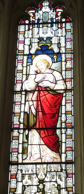 The Good Shepherd in stained glass at Northleach