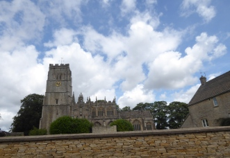 Church of St Peter and St Paul in Northleach. To the right is the old mill