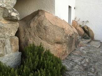 Granite boulder by the back door