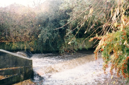 river-chelt-falls-over-a-weir-behind-what-was-st-benedicts-school-now-a-housing-estate.
