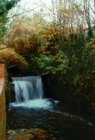 River Chelt Waterfall near old Alstone Baths once the site of a mill